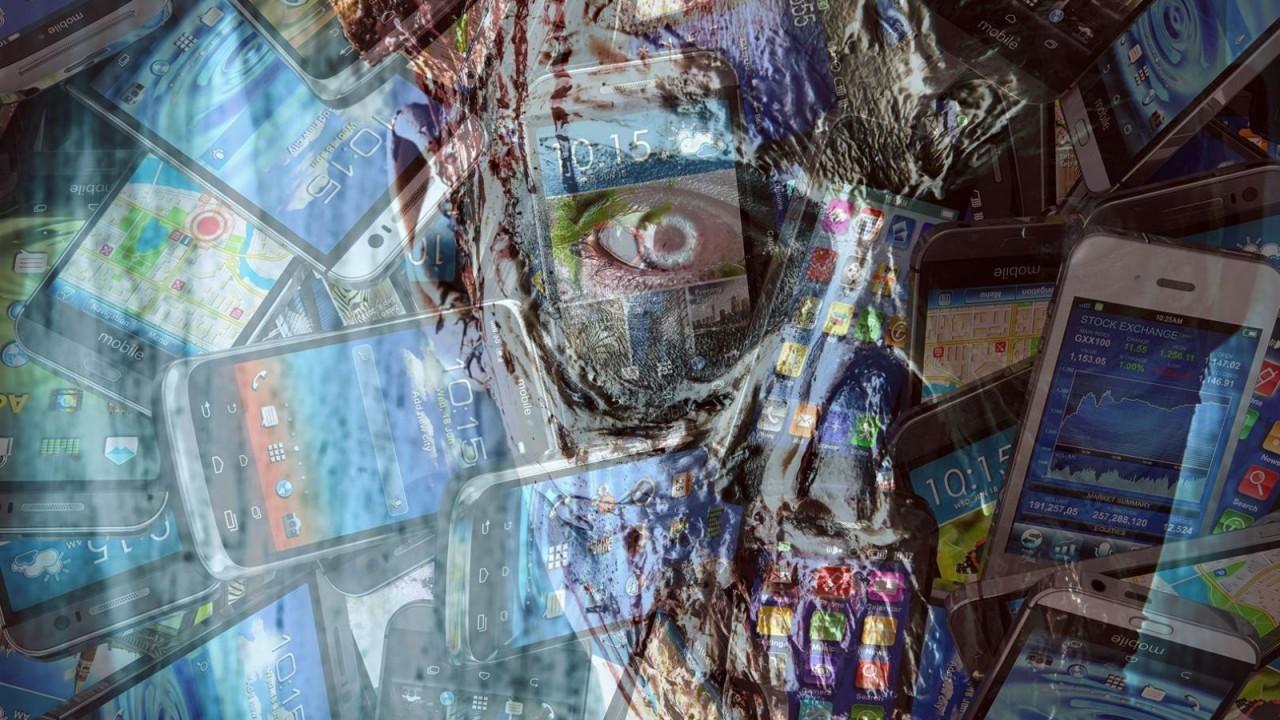Collage aus einem Zombie-Gesicht und Smartphones